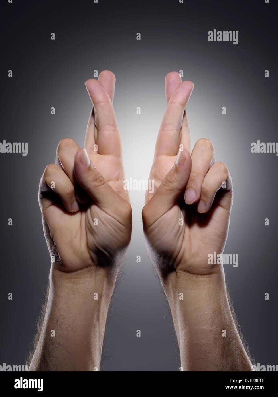 Garder les doigts croisés Photo Stock