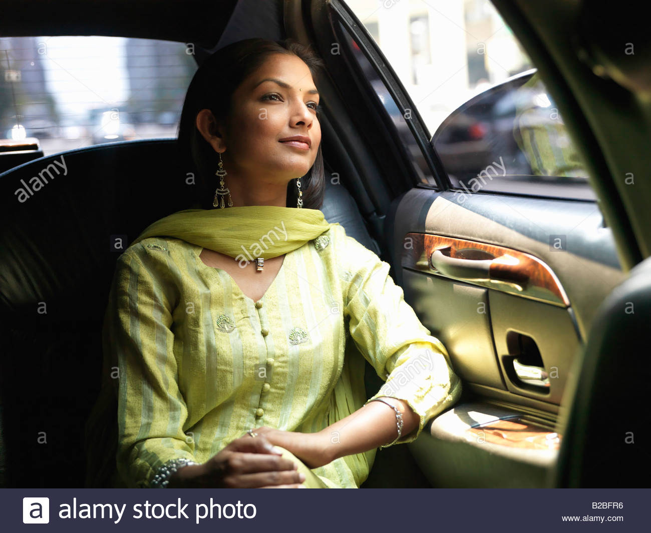 Indian woman in backseat of car Photo Stock