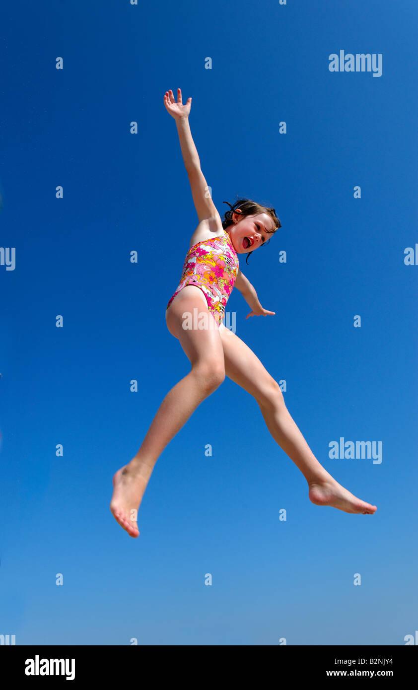 Joyful girl jumping. Photo Stock