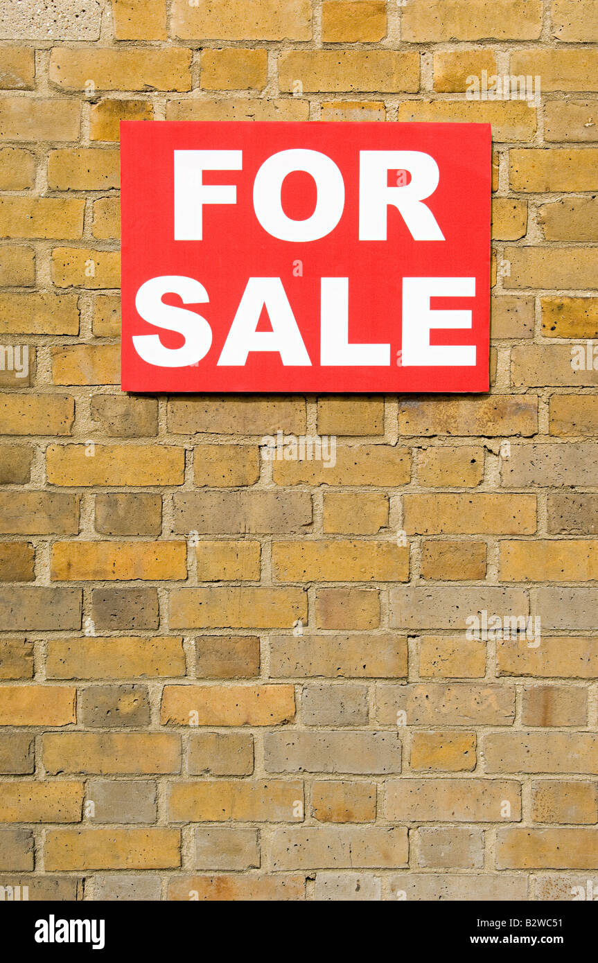 For sale sign on wall Photo Stock