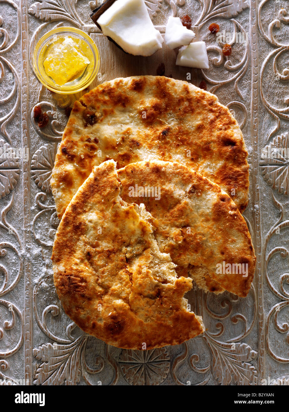 Peshwari Naan. coconut raisins et pain au miel - la cuisine indienne Photo Stock
