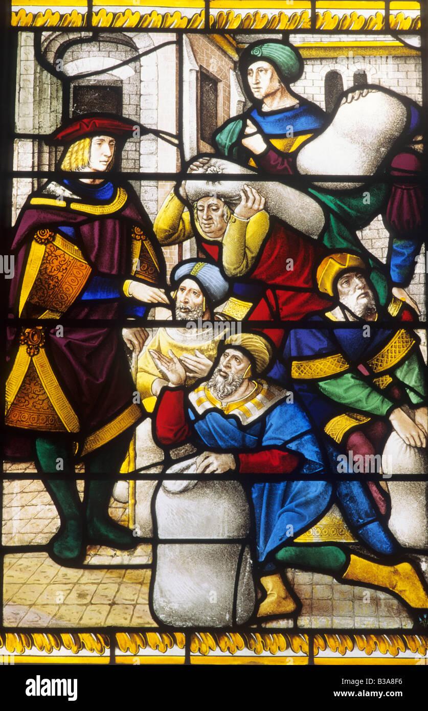 Joseph et frères avec des sacs de maïs Ancien Testament Bible Story Norfolk Earsham vitraux flamands du xvie siècle bible Banque D'Images