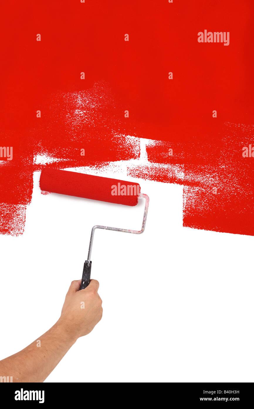 Peinture rouge avec rouleau à découper isolé sur fond blanc Photo Stock