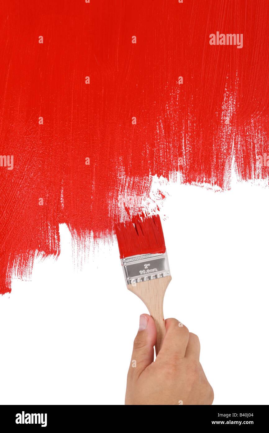 Peinture à la main avec de la peinture rouge coupé isolé sur fond blanc Photo Stock