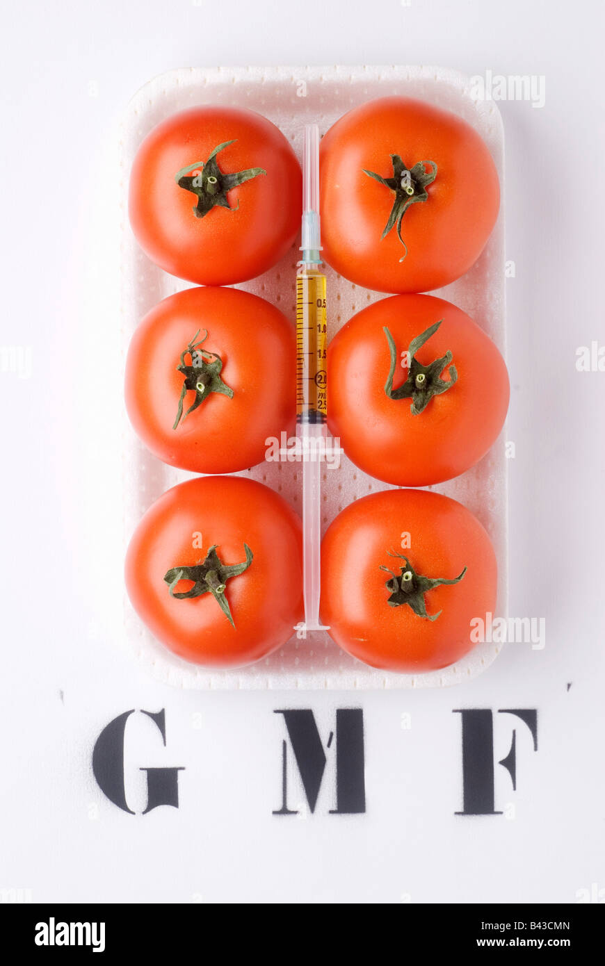 Seringue avec tomates GM Photo Stock