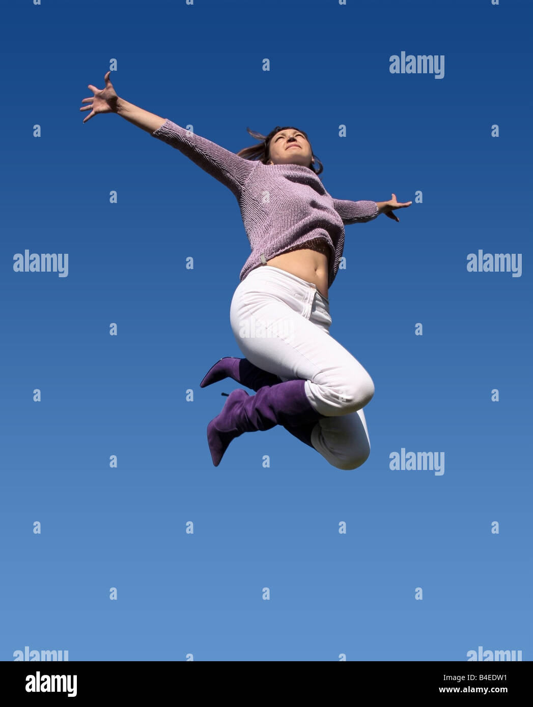 Young woman jumping high Photo Stock
