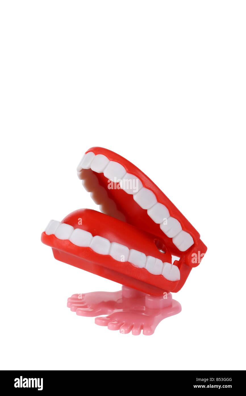 Liquider les dents de broutement découpe jouet isolé sur fond blanc Photo Stock