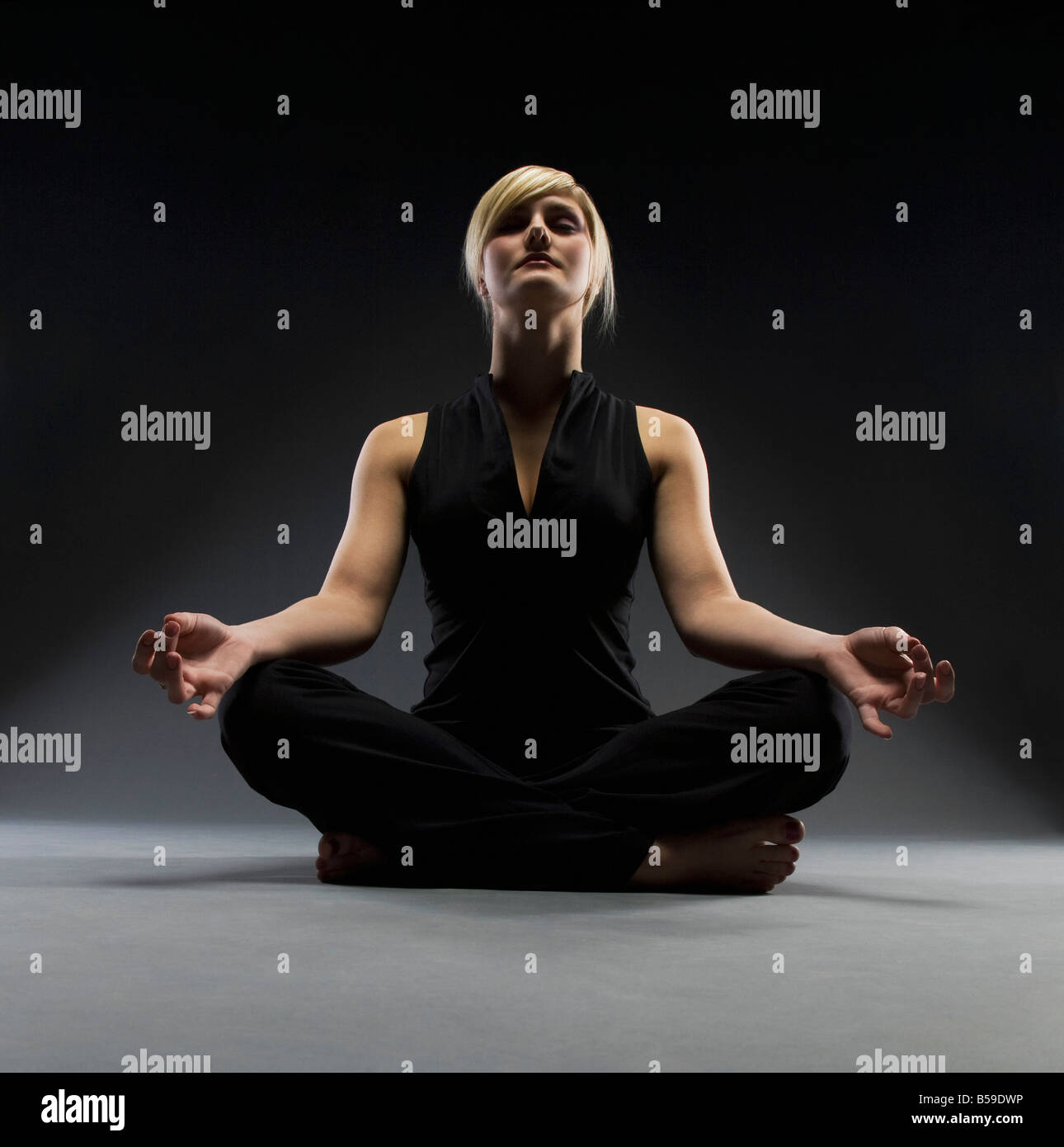 Woman meditating Photo Stock