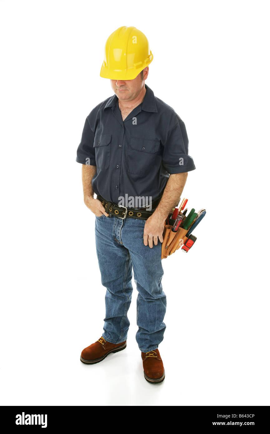 Déprimé baissés travailleur de la construction s'interroger sur ses perspectives d'emploi Photo Stock