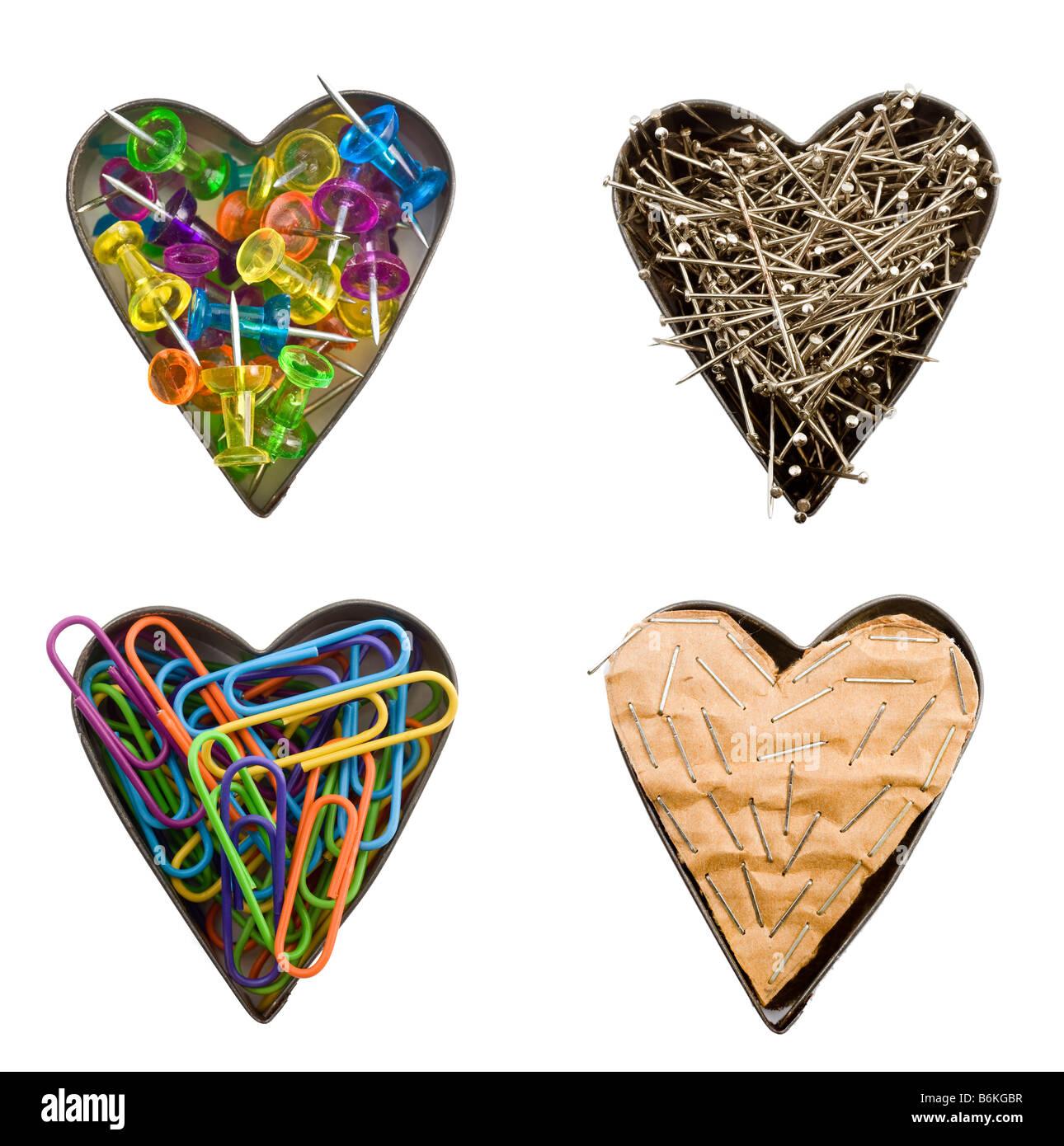 Quatre cœurs avec éléments de bureau Photo Stock