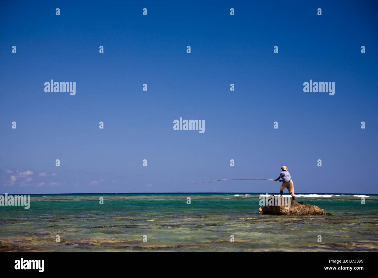 Canne A Peche Fait Maison man sea fishing off beach photos & man sea fishing off beach