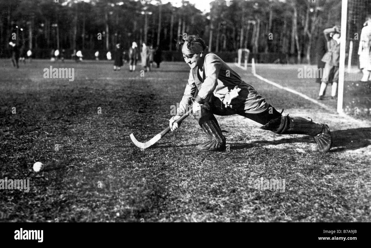 Photo historique, femme jouant au hockey, ca. 1925 Photo Stock