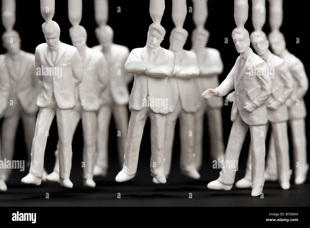 Un groupe d'hommes d'affaires moyen en plastique figurines Photo Stock