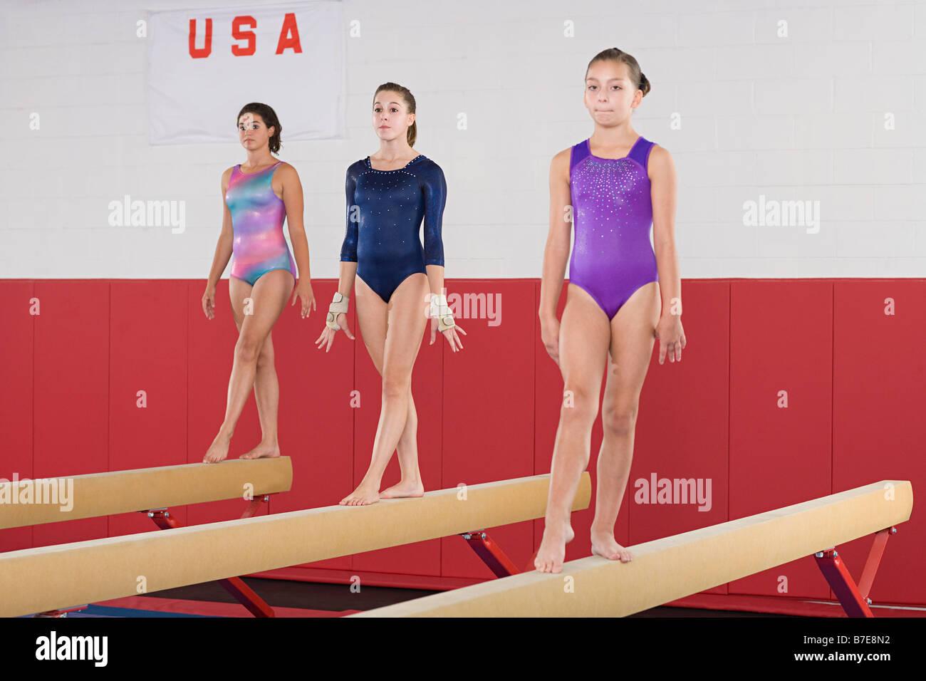 Les gymnastes sur une balance Photo Stock