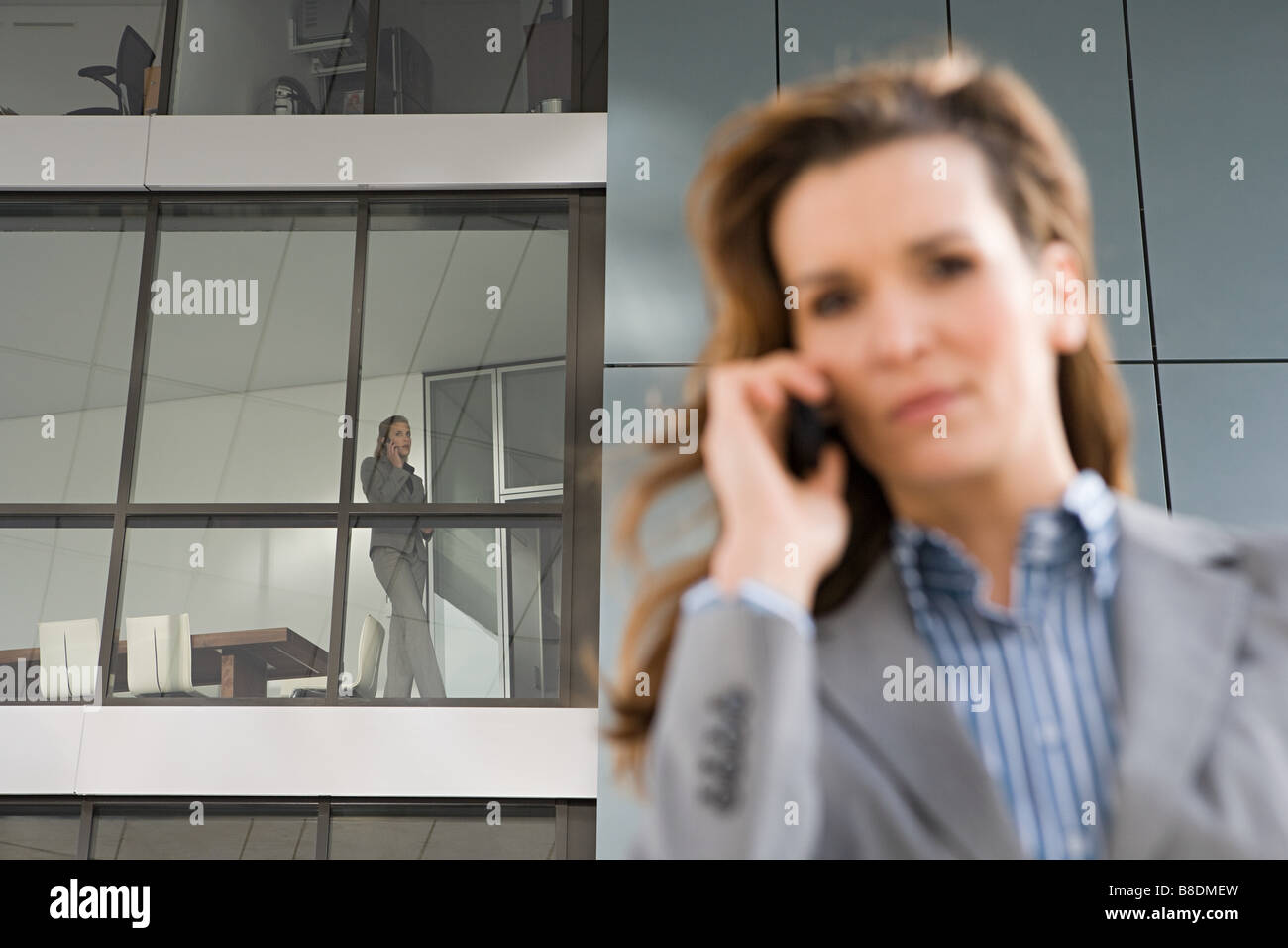 Businesswoman on cellphone Photo Stock
