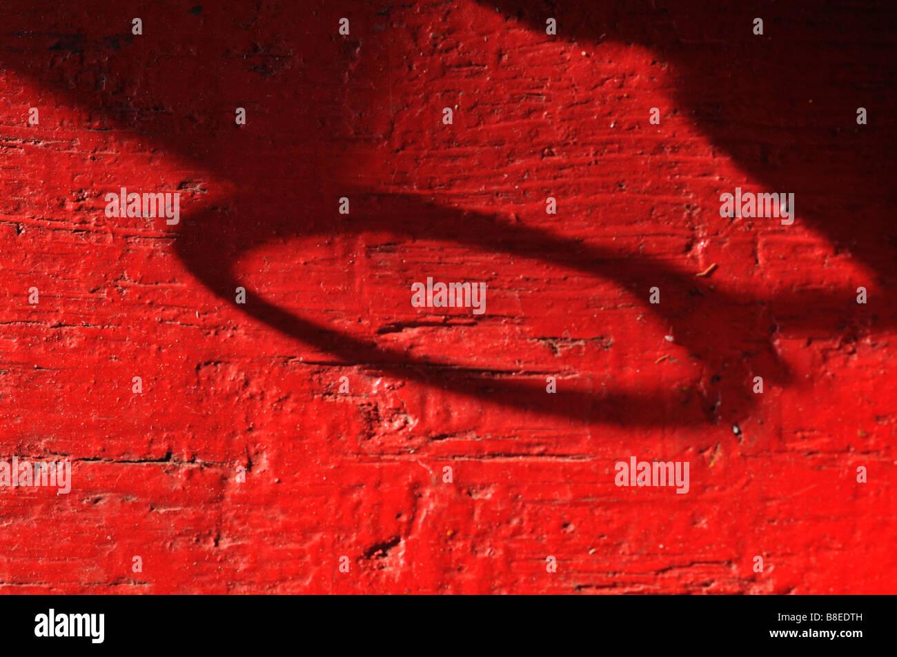 De la peinture rouge et ombre ellipse Photo Stock