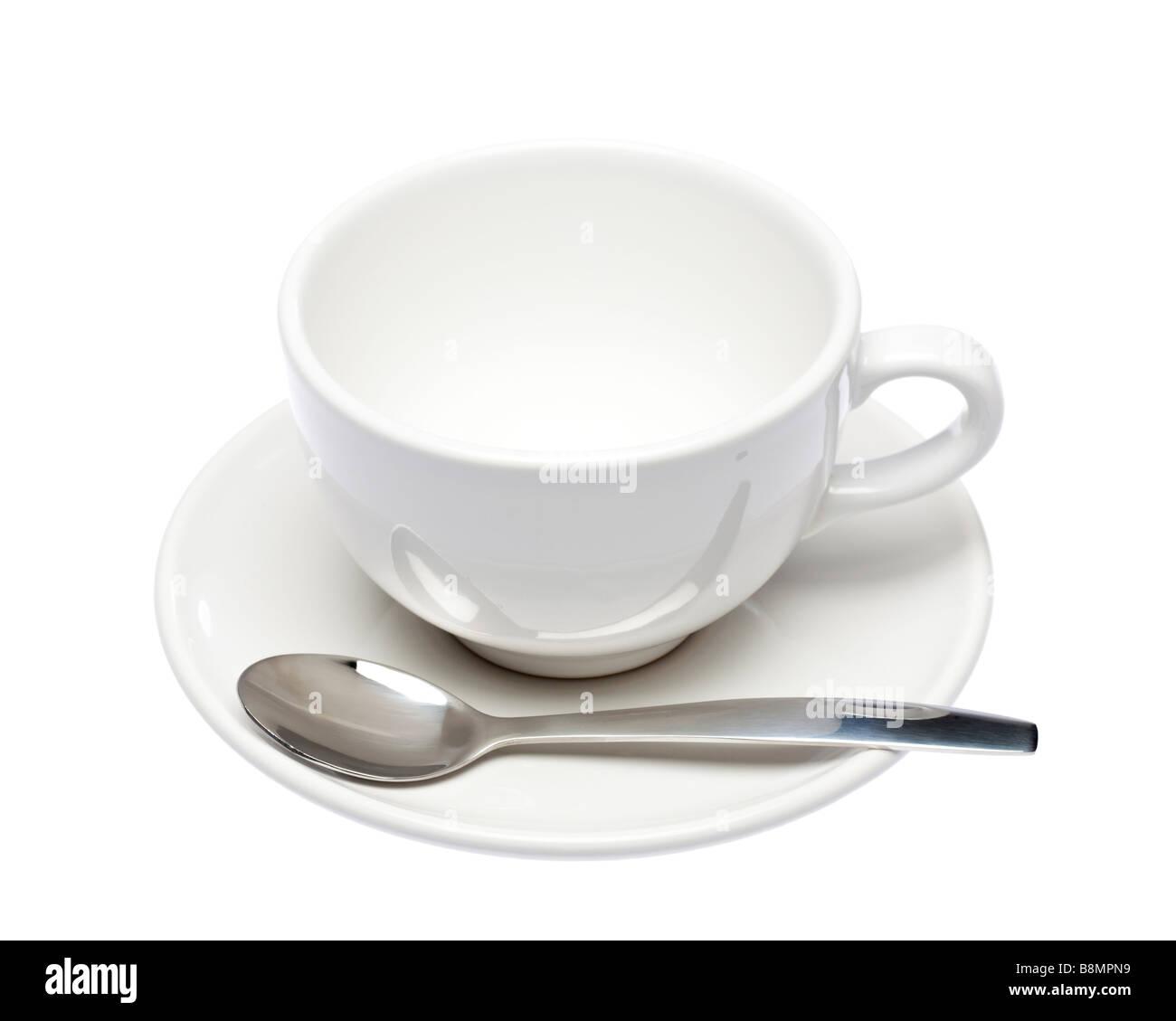 Tasse et soucoupe blanche vide avec cuillère sur découpe blanc Photo Stock