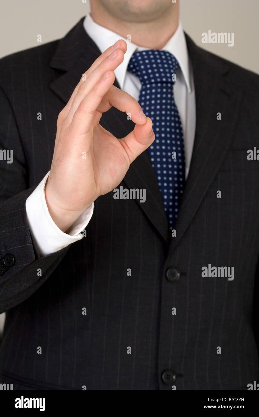 Businessman indiquant que tout va bien Photo Stock