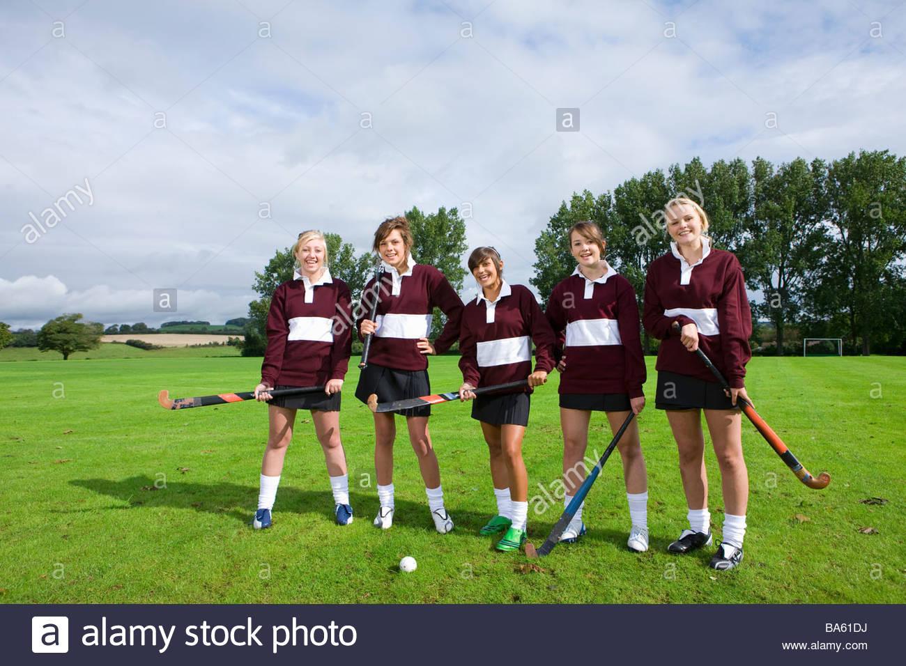 L'équipe de hockey sur gazon adolescente Photo Stock
