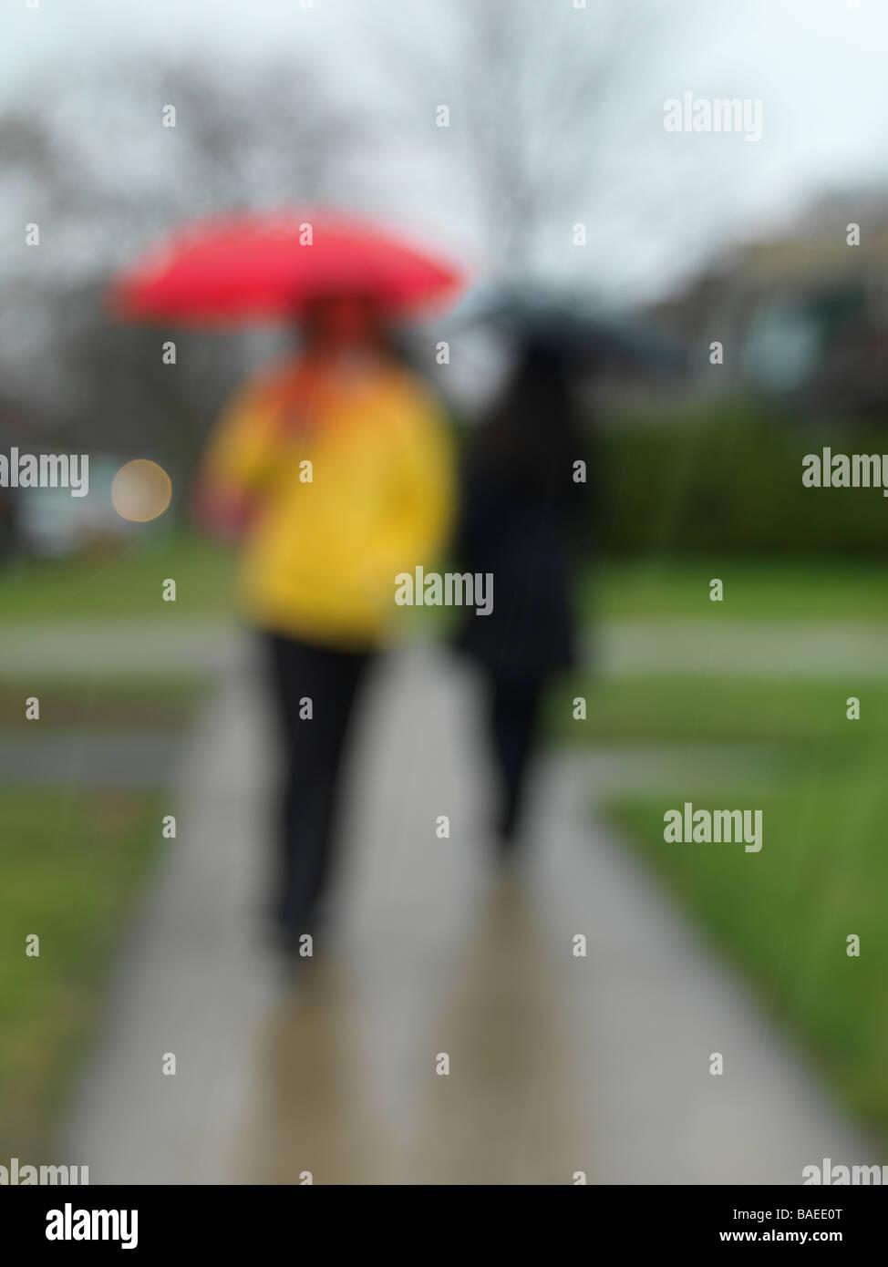Personnes sous la pluie Photo Stock