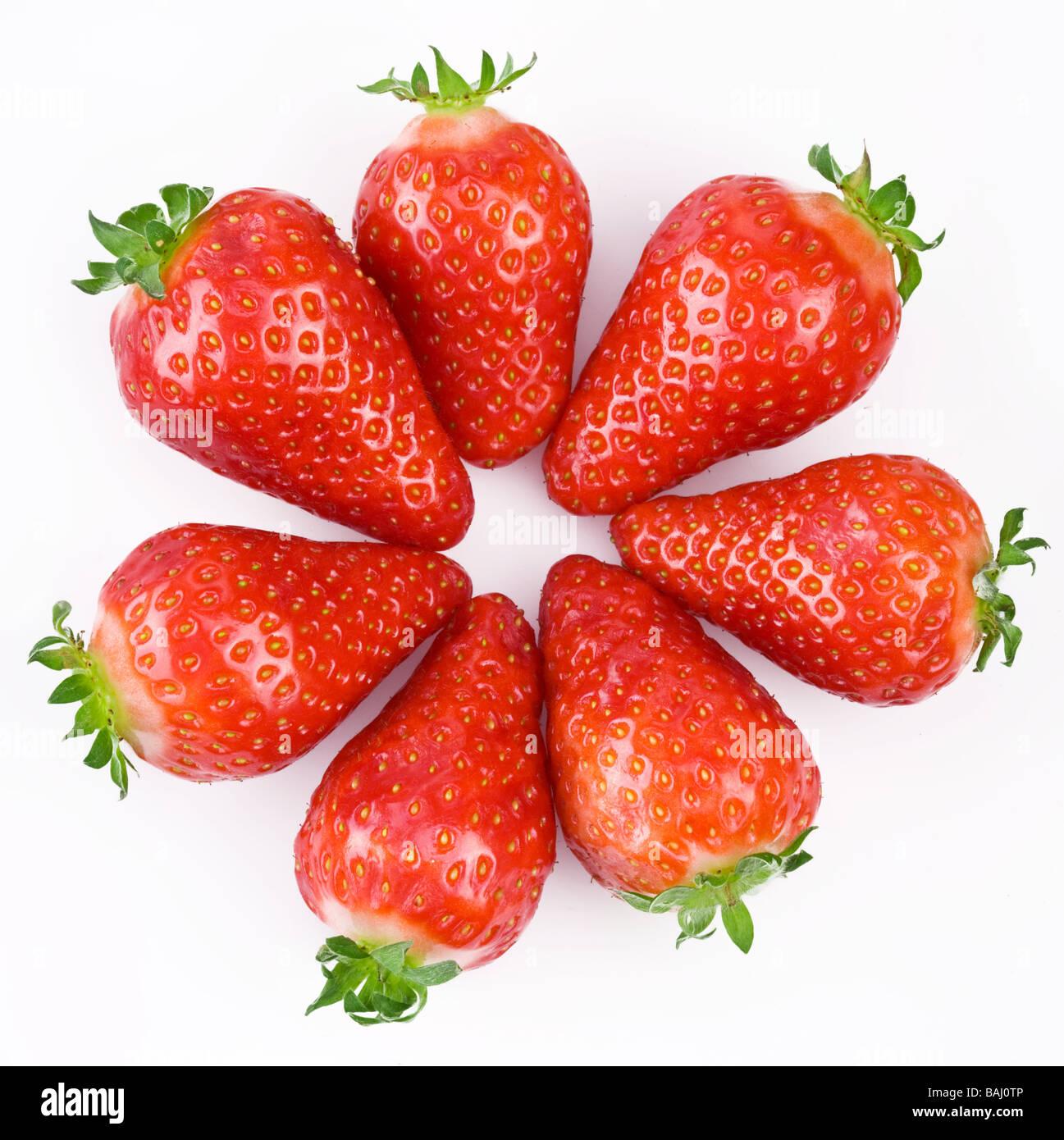 Les baies de fraise sur un fond blanc Photo Stock