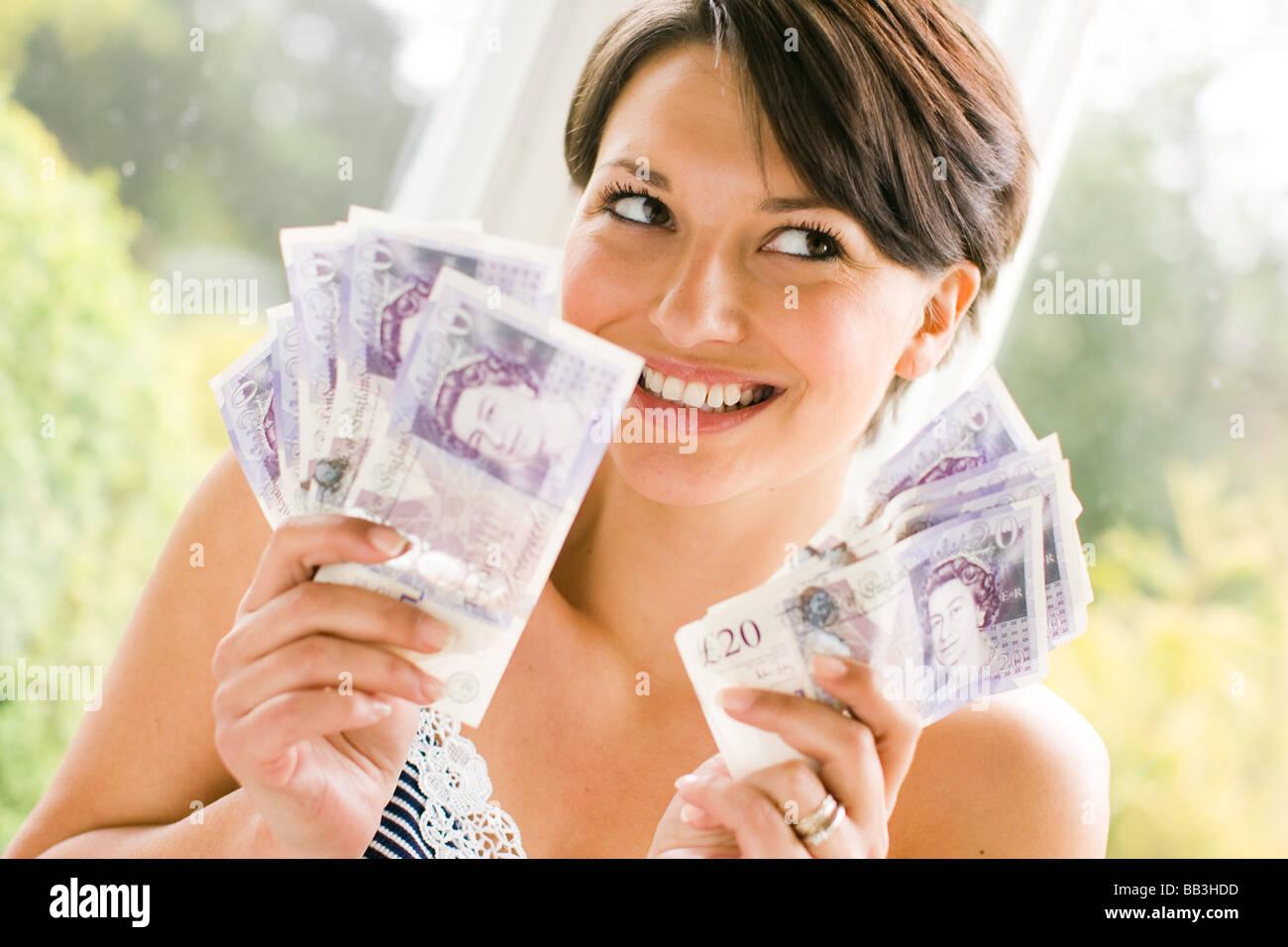 Fille avec de l'argent Banque D'Images