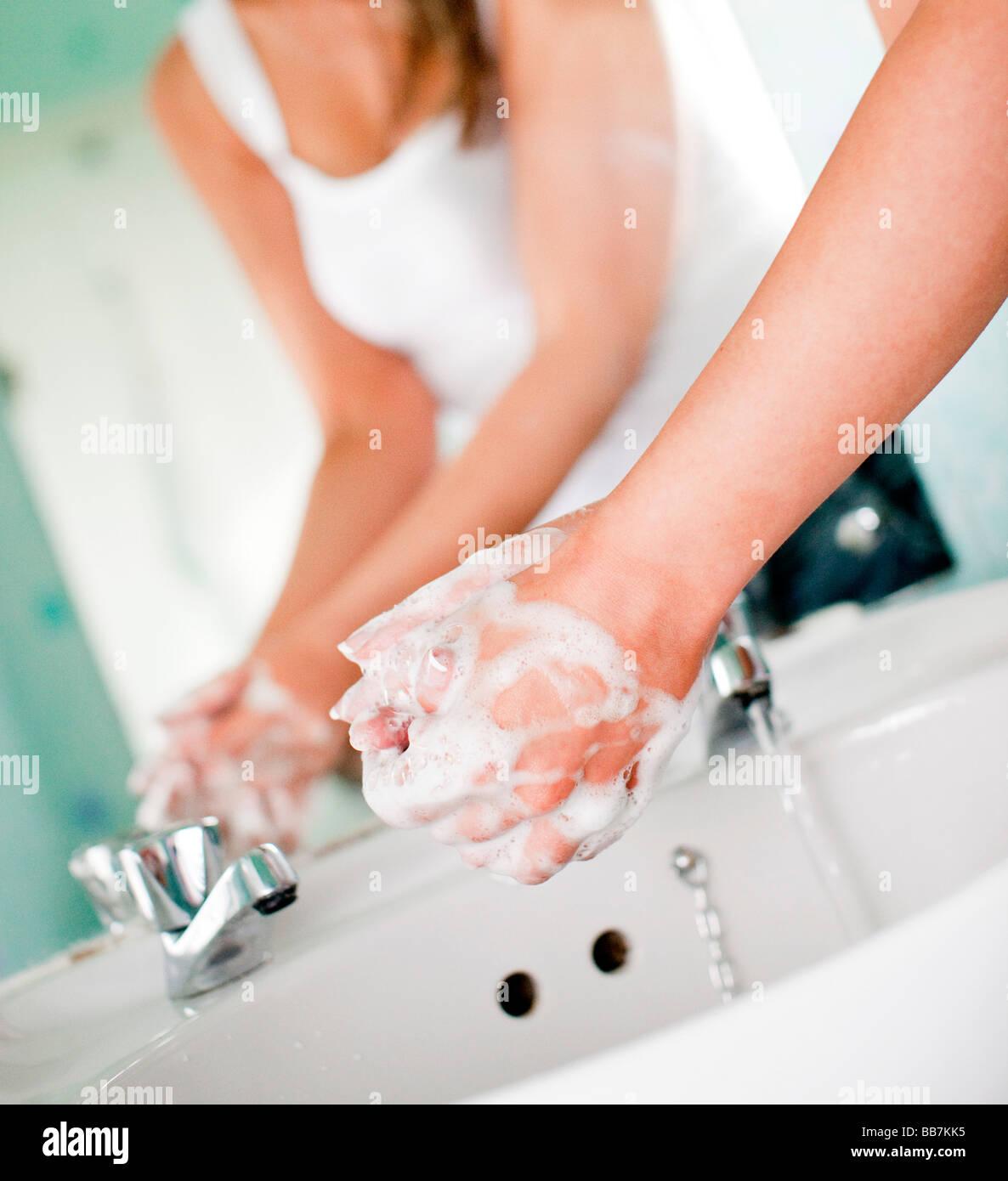 Woman washing hands Photo Stock