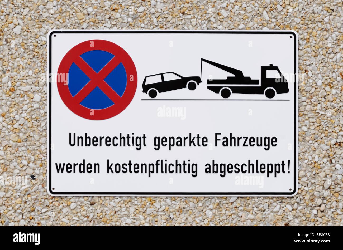Inscrivez-vous sur du gravier, béton voitures non autorisée sera remorqué de, propriétaire sera Photo Stock
