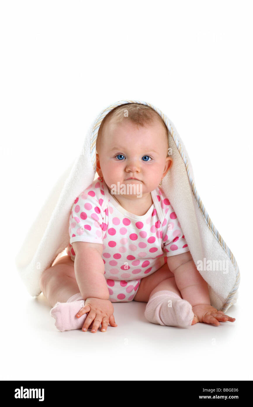 Cute baby sitting with towel on head isolated over white Photo Stock