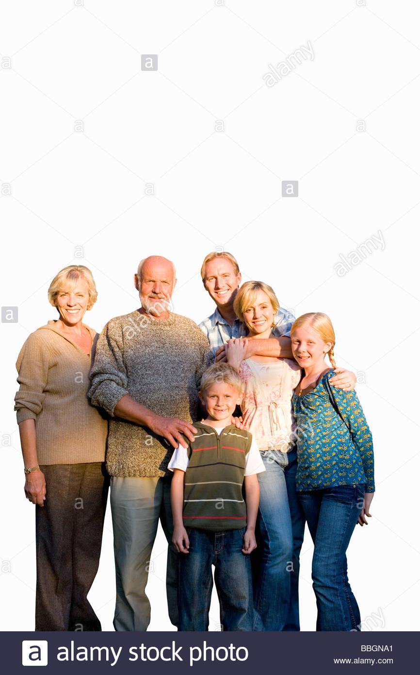 Trois générations de la famille bras dessus bras dessous, smiling, portrait, cut out Photo Stock