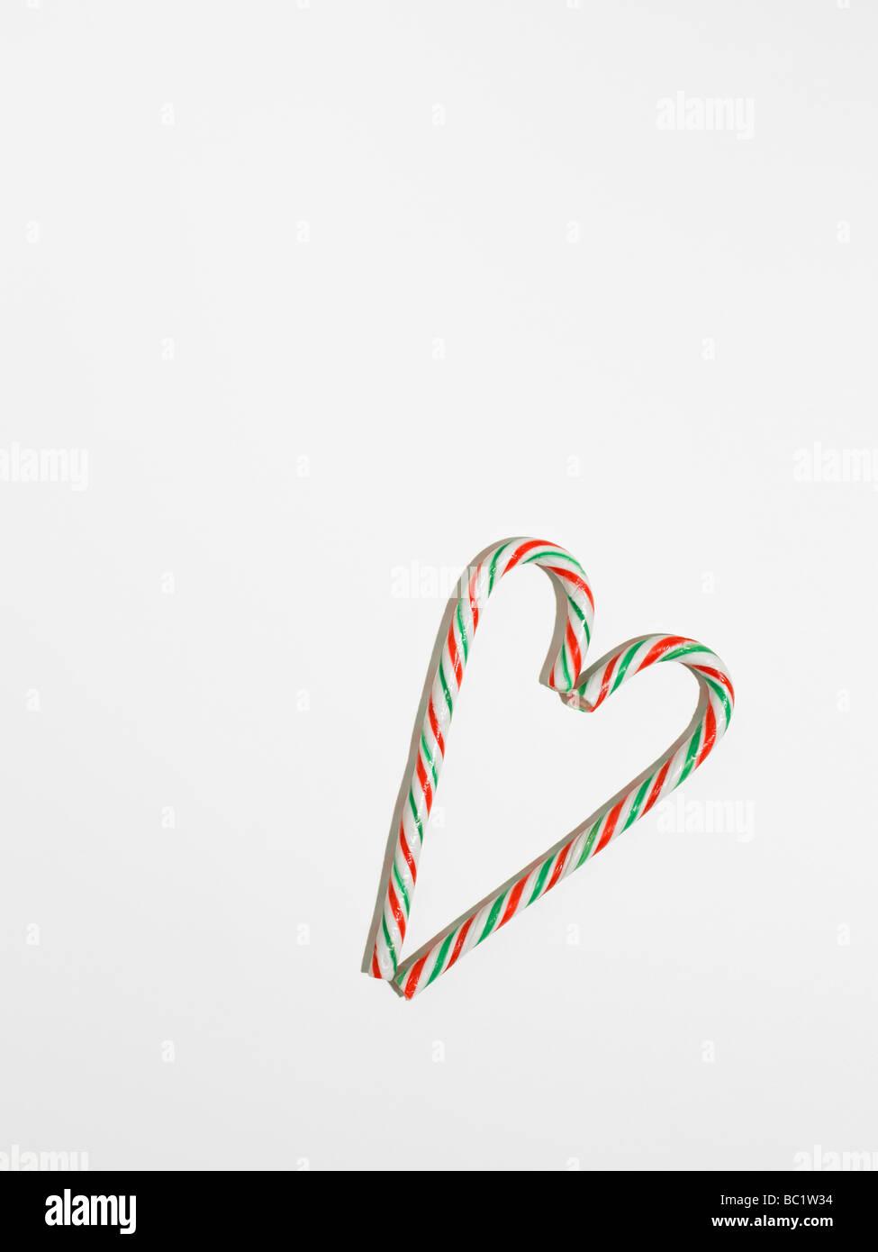Bâtonnets de cannes de bonbons en forme de coeur Photo Stock