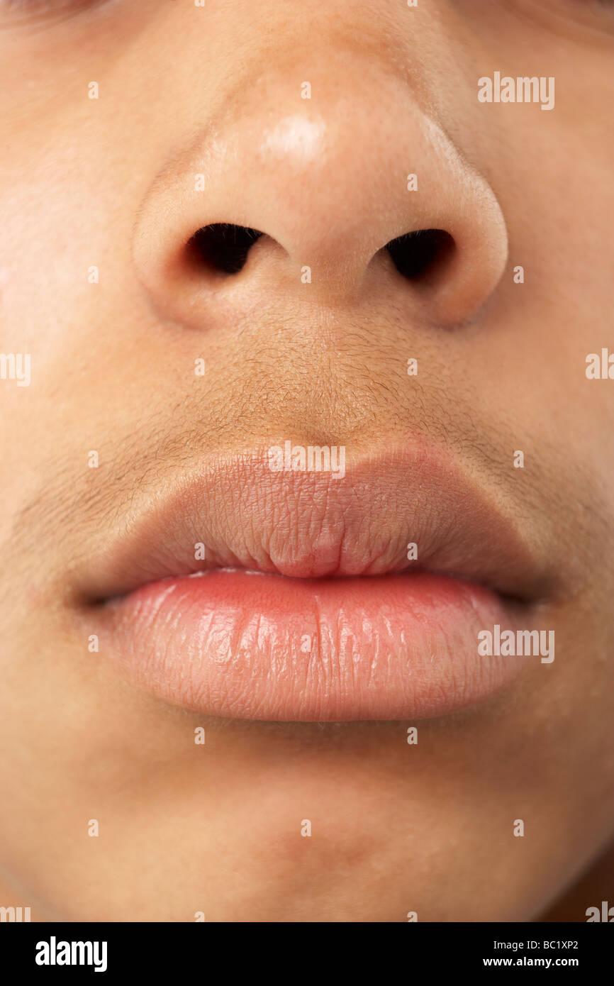 Portrait de Jeune garçon, la bouche et le nez Photo Stock