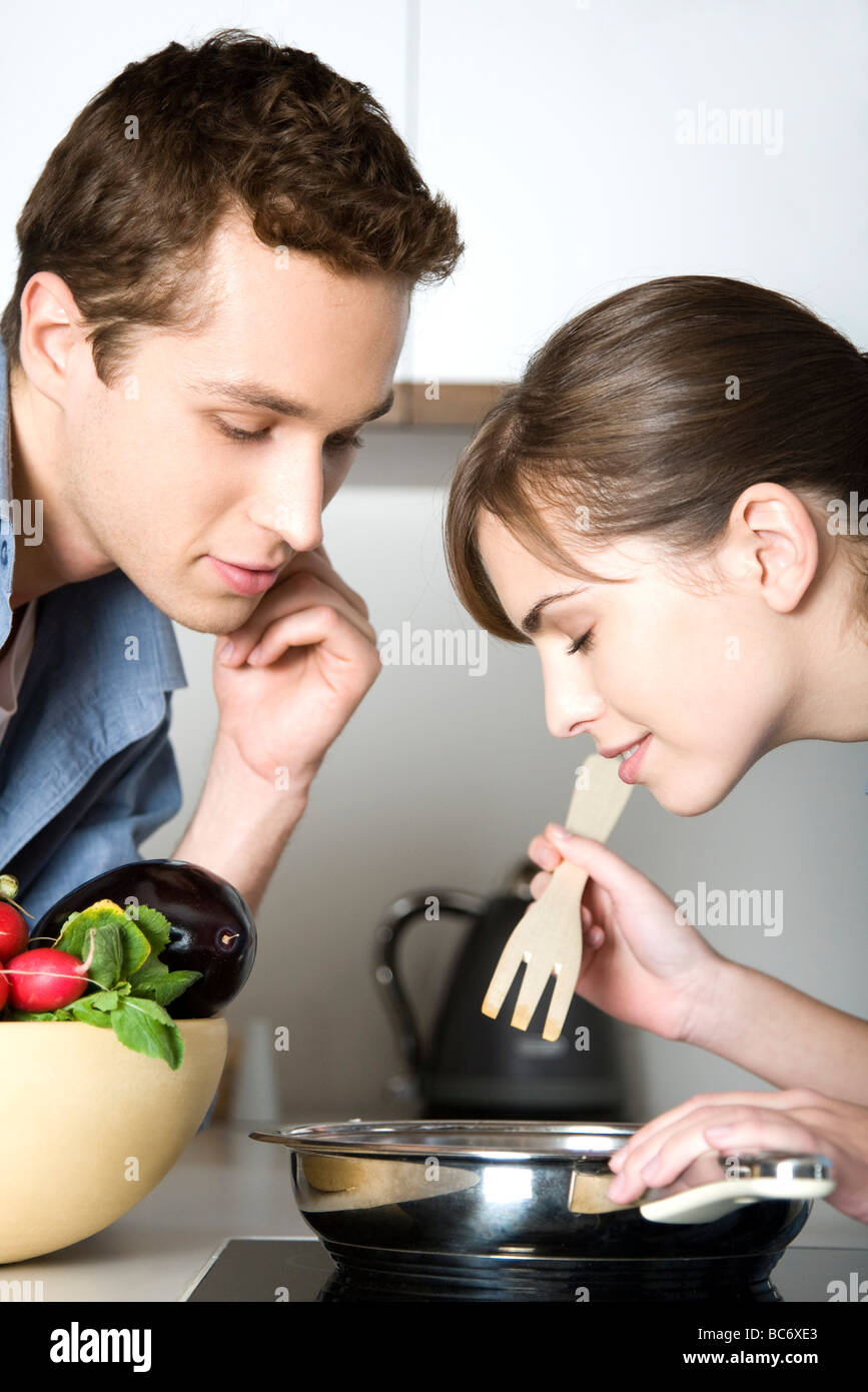 Couple cooking together Photo Stock