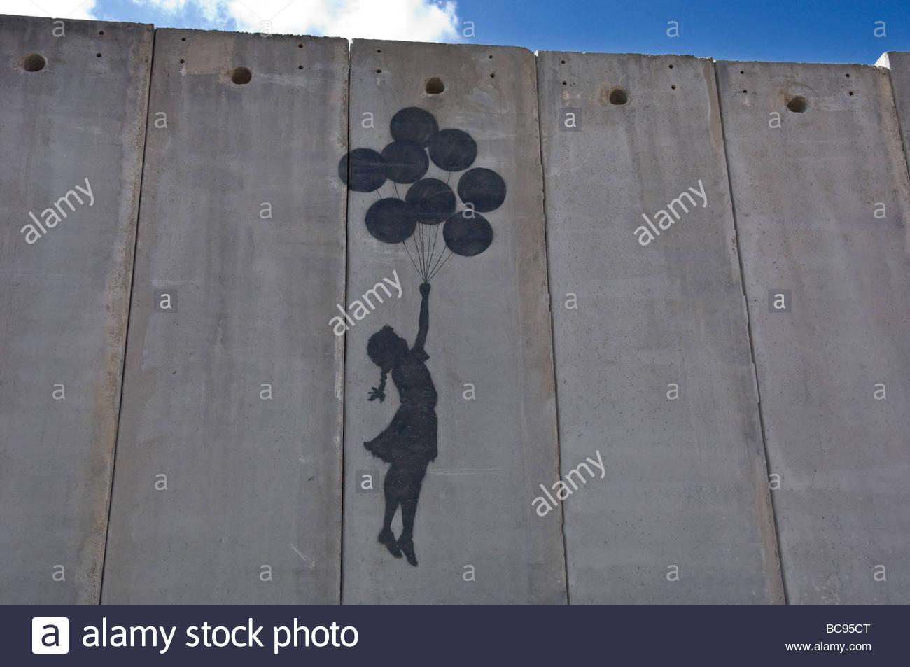 Une peinture sur le mur Separartion israéliennes à Jérusalem-est près de la frontière avec Photo Stock