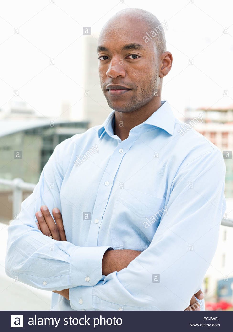 Portrait of businessman standing on balcony Photo Stock