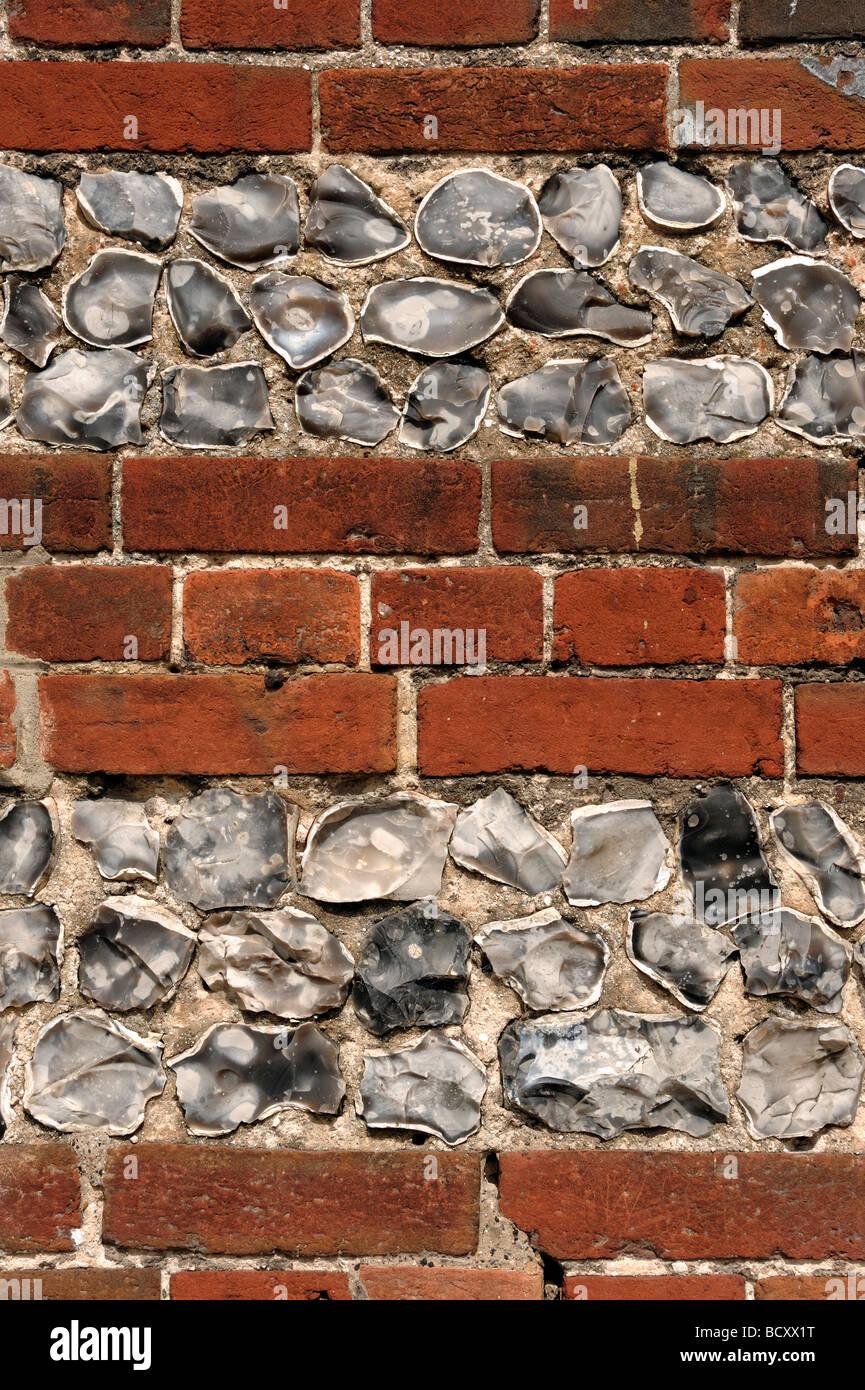 Mur de briques et silex Photo Stock