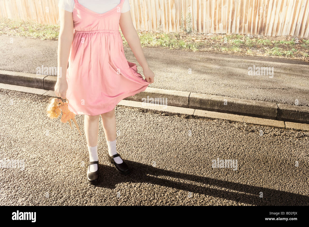 Abstract girl posing holding doll Photo Stock