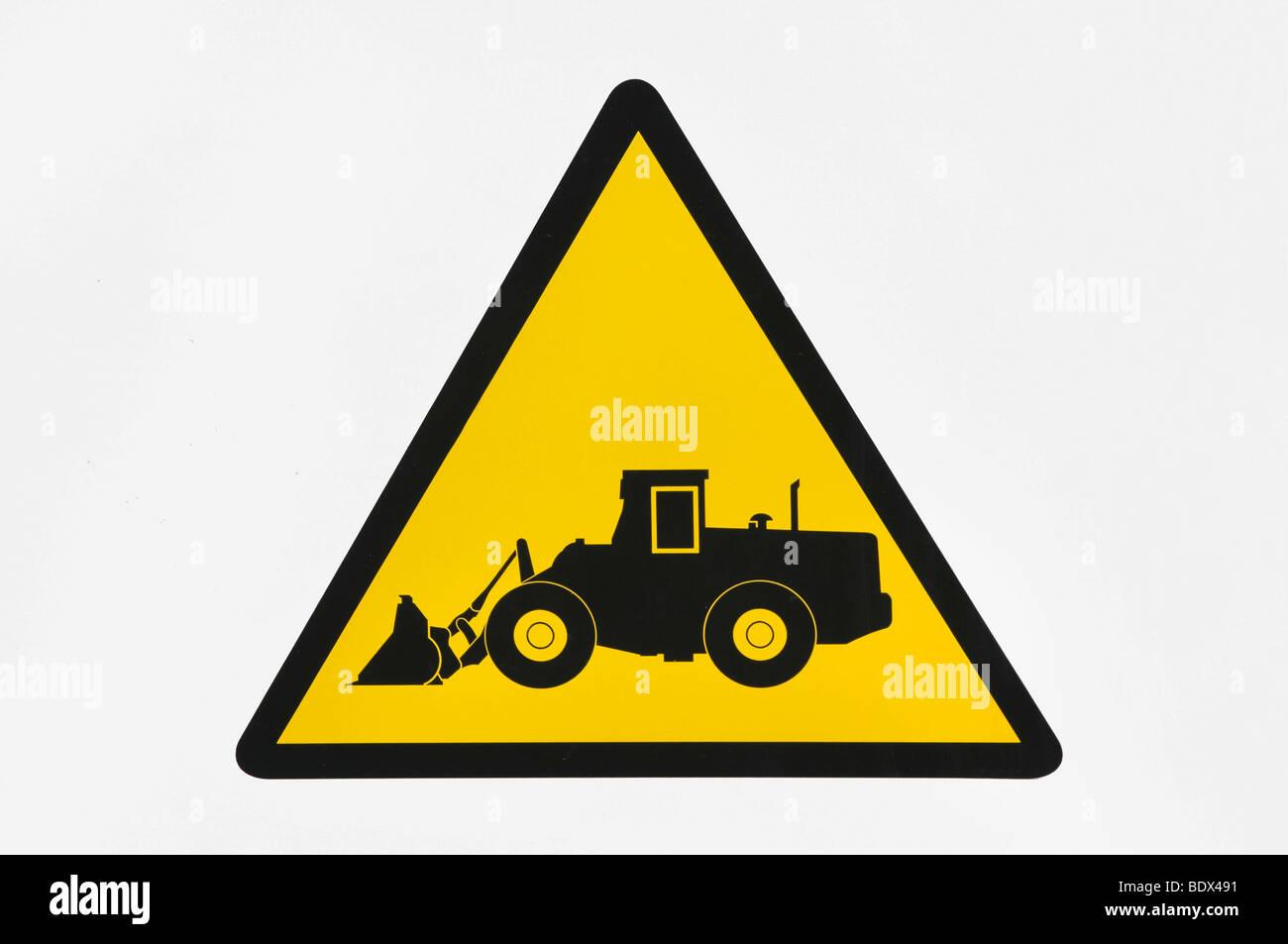 Panneau d'avertissement, attention aux véhicules de construction Photo Stock