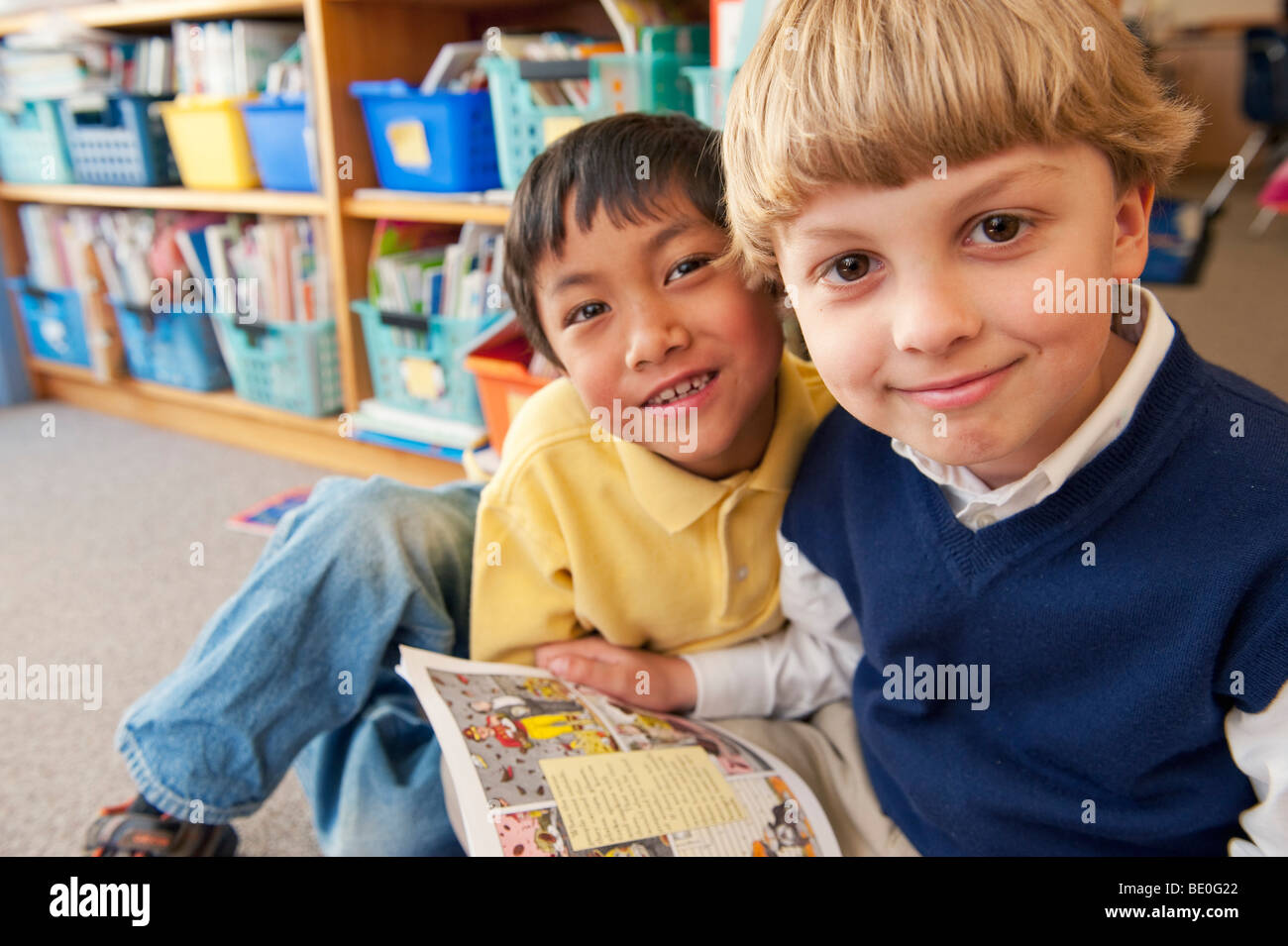 Students reading book together Photo Stock