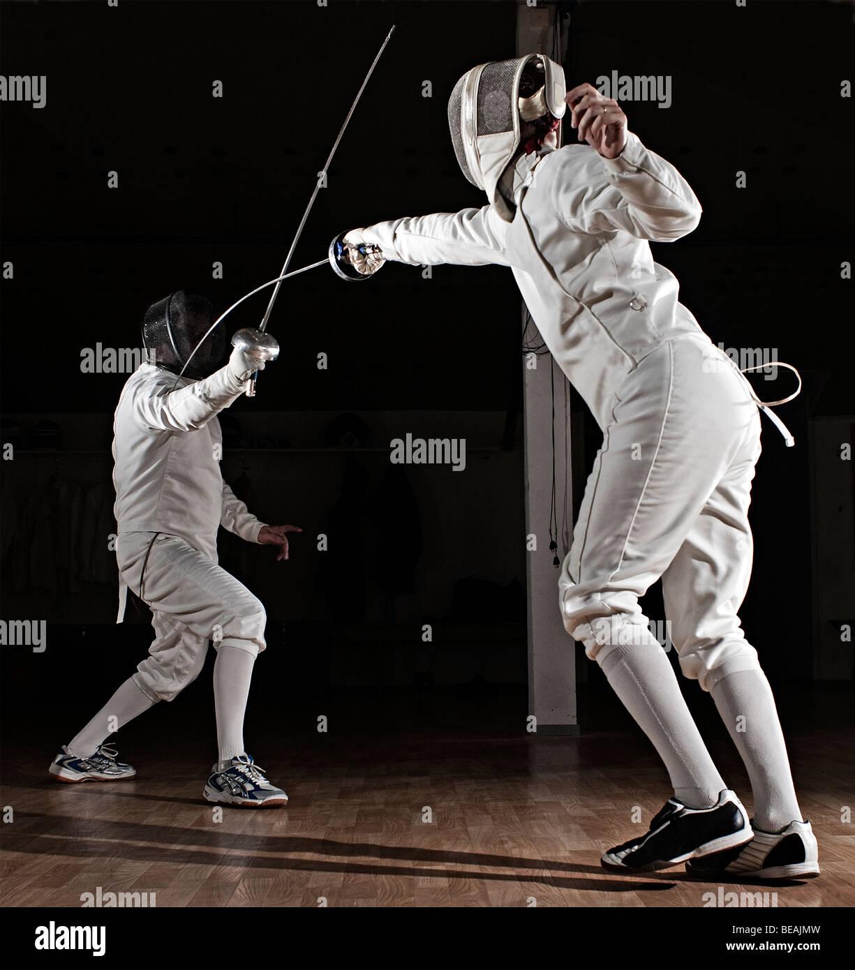 Épée swordsmen fencing. Photo Stock