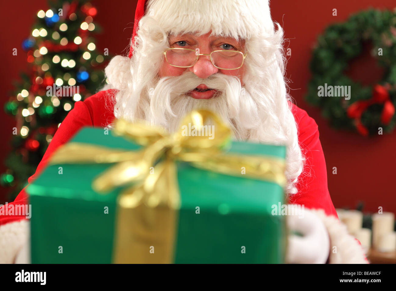 Santa Claus giving gift Photo Stock
