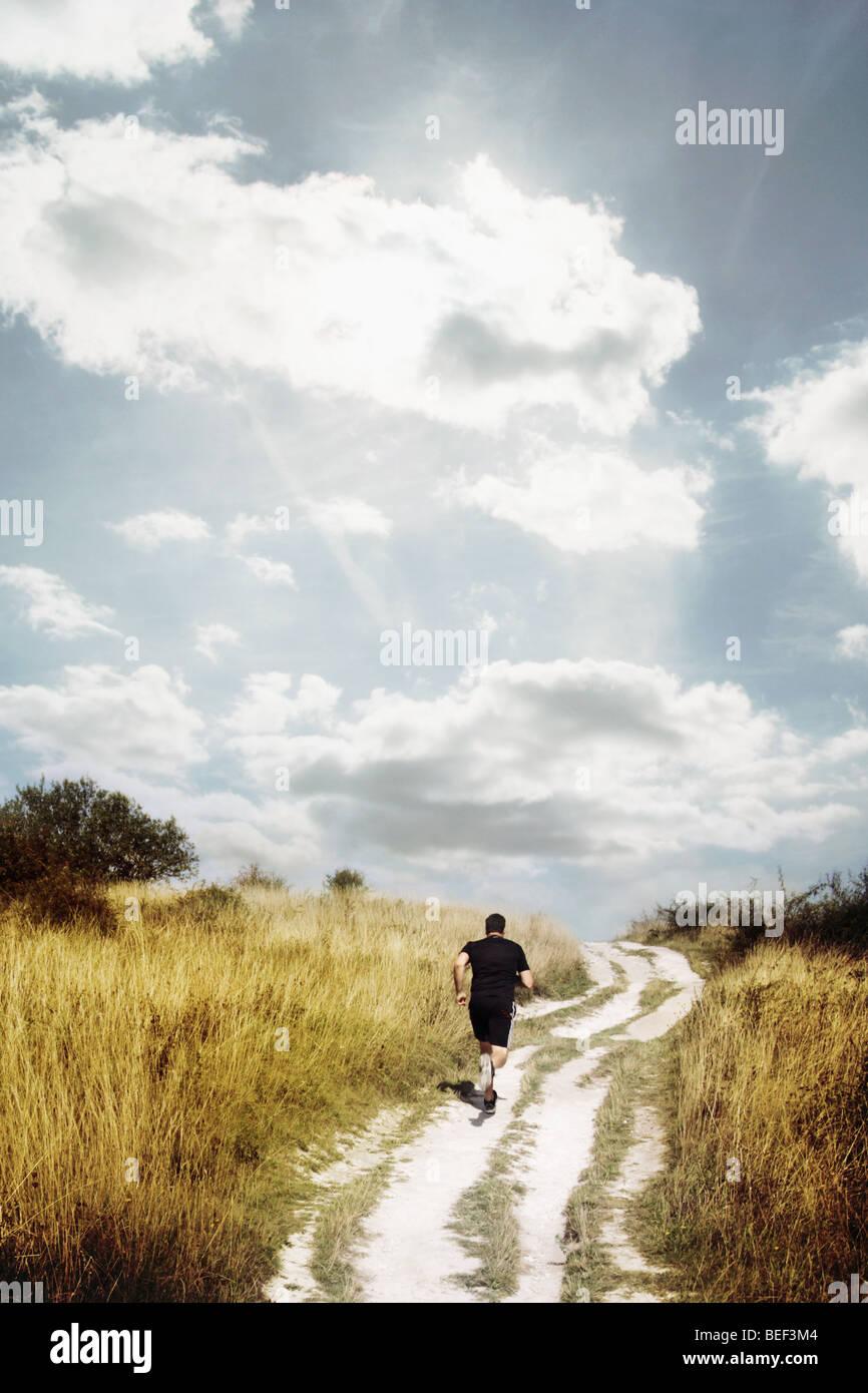 Homme qui court une piste Photo Stock