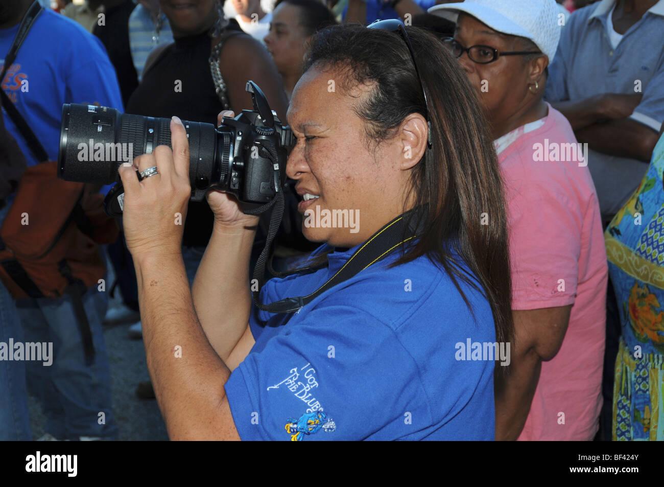 Photographe prend des photos à un événement Photo Stock