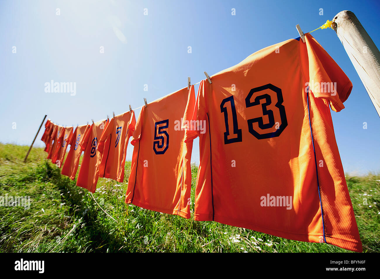 Robes football hanging on clothesline Photo Stock