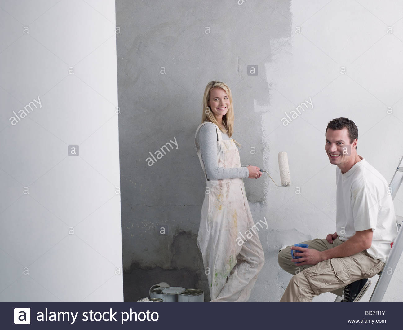 Couple painting wall Photo Stock