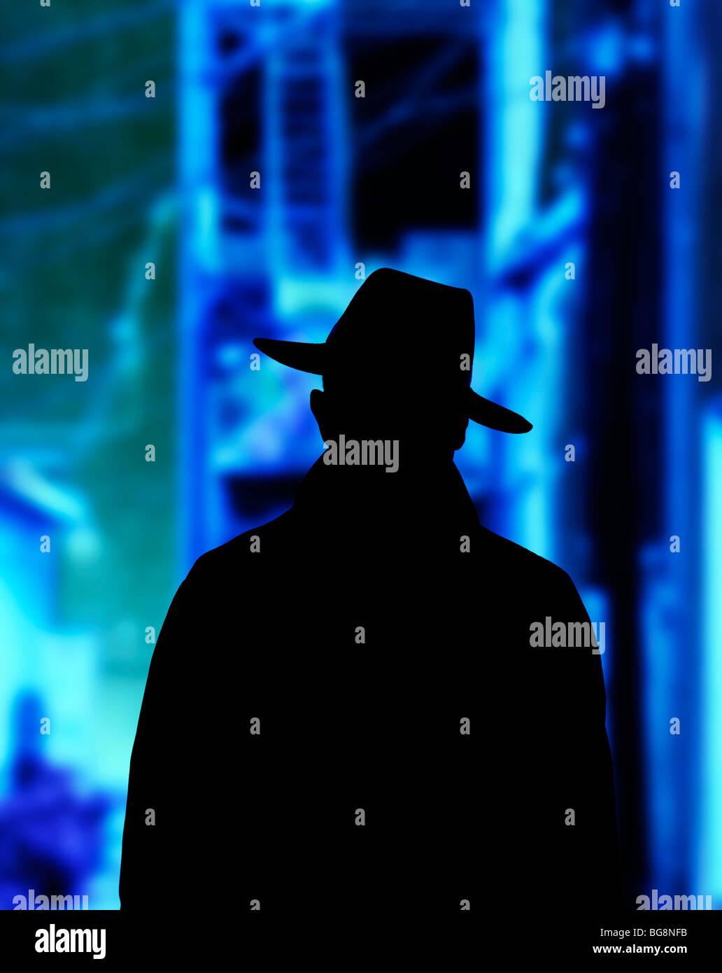 Sinister à bad guy dans la région de alley la nuit Photo Stock