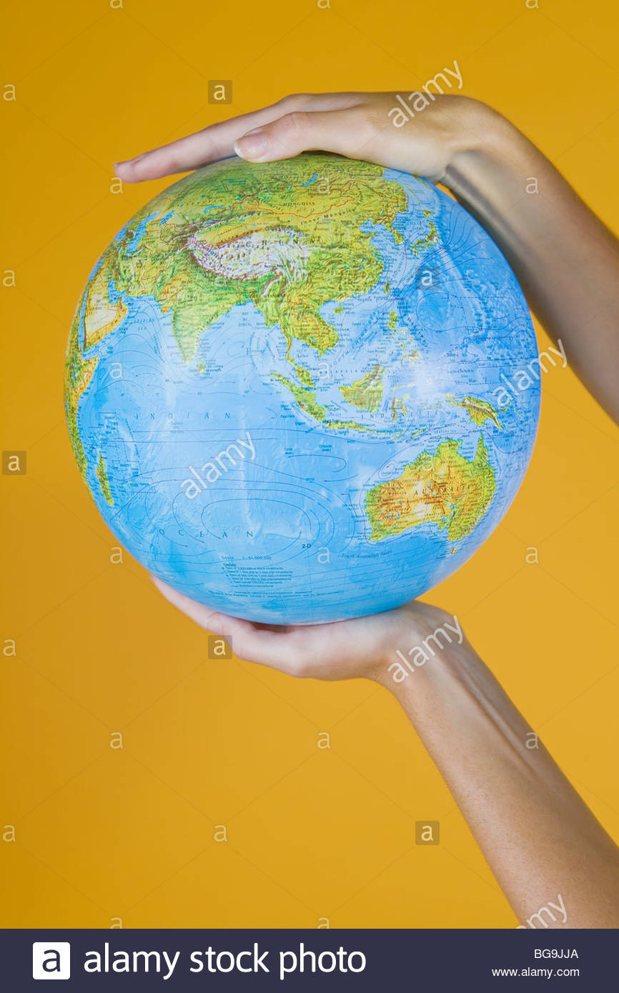 Hands Holding A Globe Photo Stock