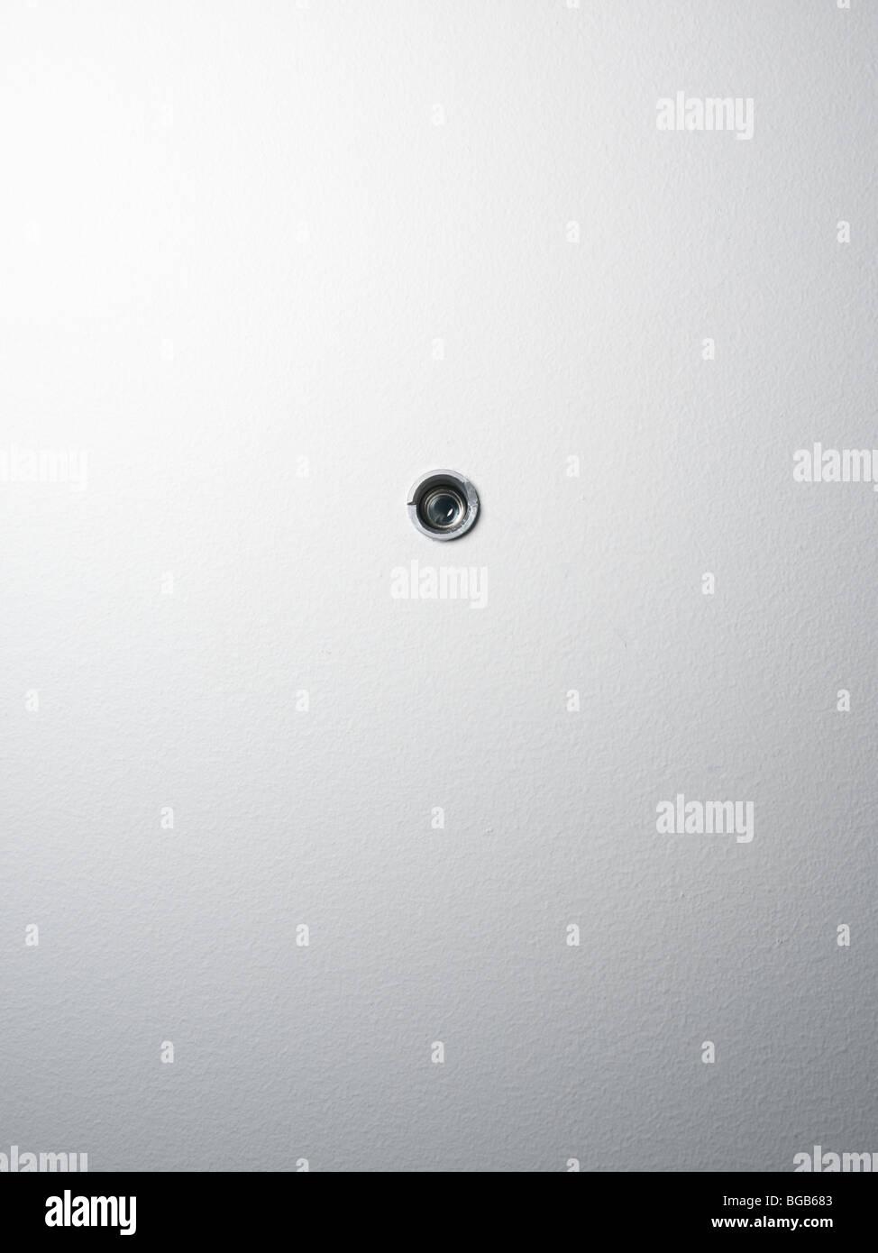 Trou espion dans une porte Photo Stock