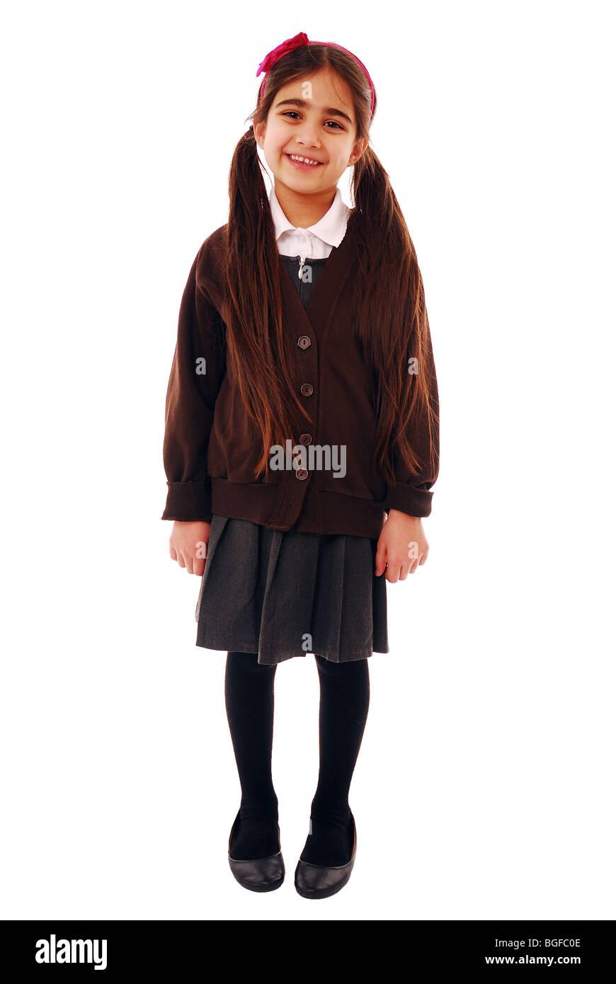 Jeune fille dans l'uniforme scolaire Photo Stock