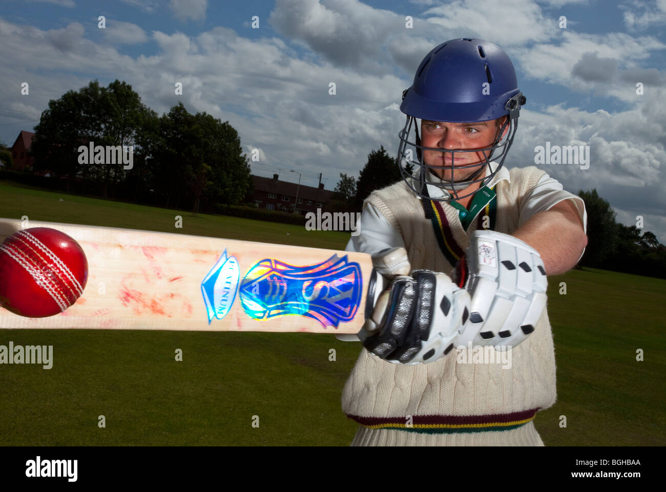 Joueur de cricket ball batteur bat Photo Stock